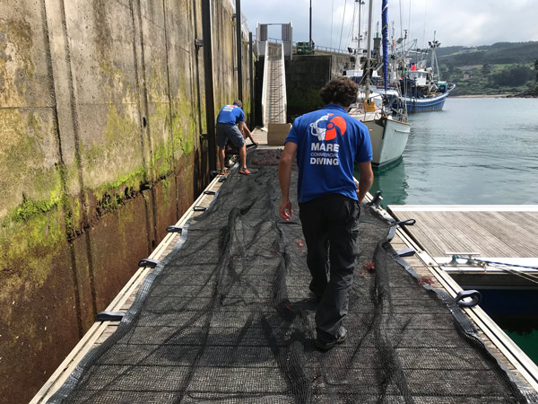 Preparation of farming nets for installation at sea